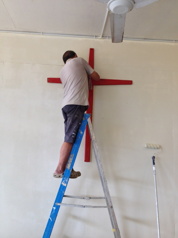 cleaning the cross in the multipurpose hall