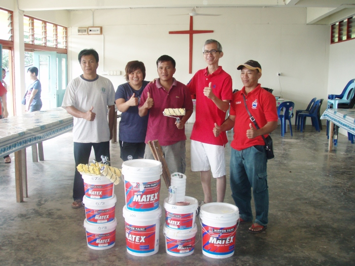 handing over of the leftover paint to the church workers