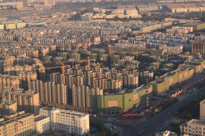 Xinjiang is being massively developed and there are constructions of boxy highrises everywhere in Ürümqi