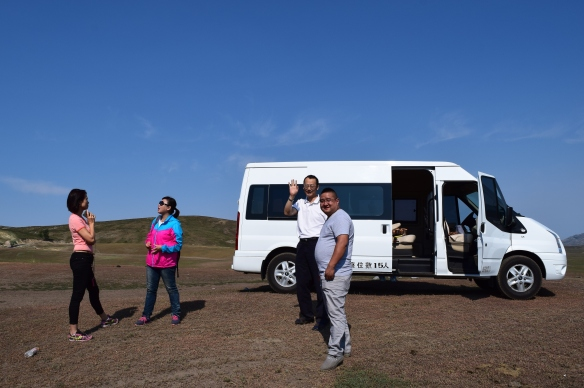 the van that has clocked in hundreds of miles taking us around Xinjiang (from left: May, our guide Xiao Gong for Burqin and Kanas, host Mr Zhang and driver Xiao Wang)