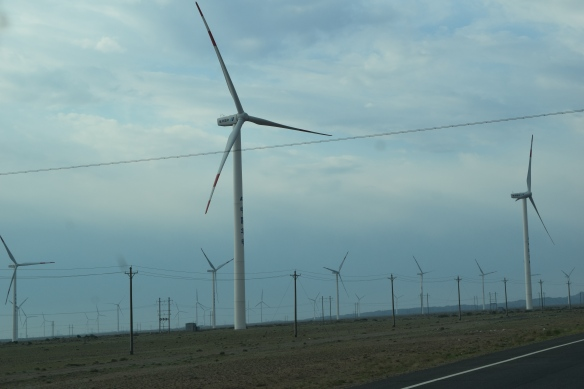 barren desert with only wind turbines