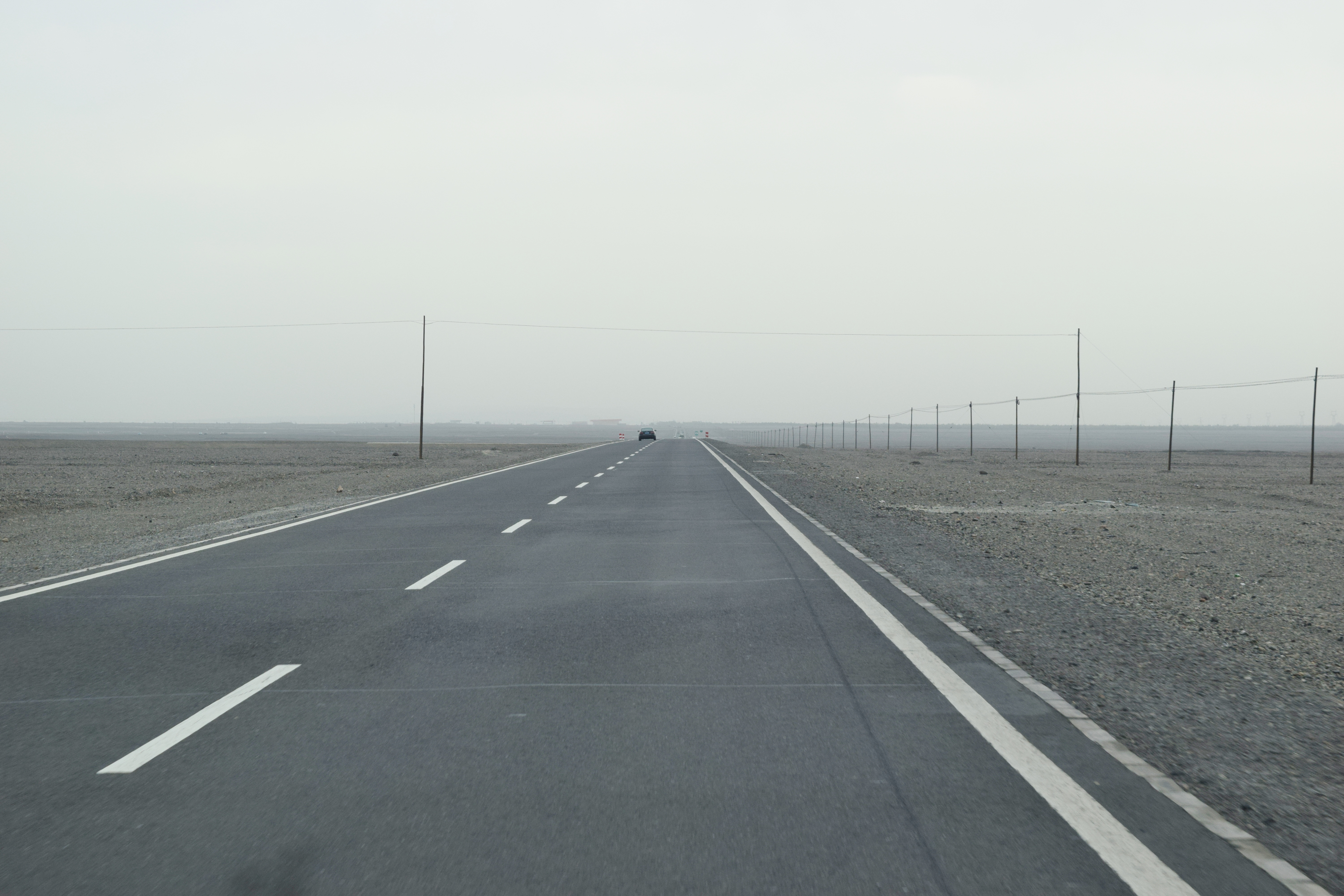 miles and miles of absolute nothingness on both sides of the road but Gobi (戈壁) sand! 寸草不生!