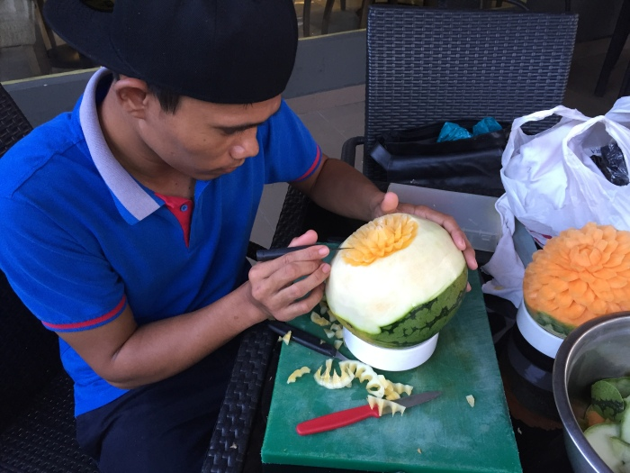 our kitchen steward Ahzimin practising on fruit carving and getting himself ready to represent our hotel at the Hospitality Fiesta Talent Competition on Saturday